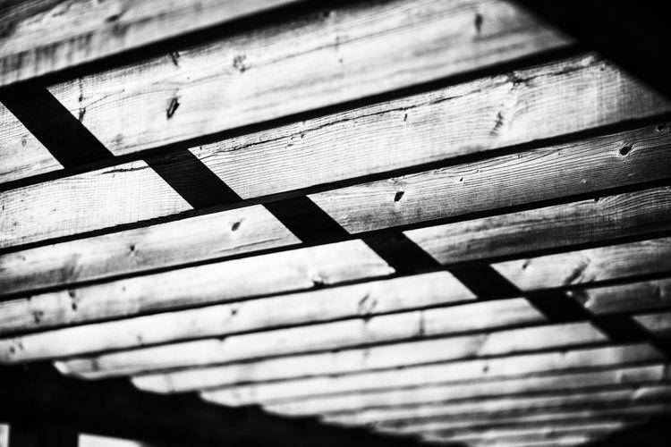 Full frame shot of planks with sunlight
