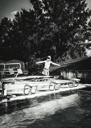 Little Boy Diving Board Jumping In Pool Blackandwhite Photography EyeEm Best Edits EyeEm Best Shots - Black + White Swimmingpool
