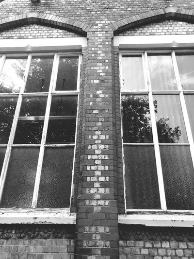 Architecture Window Built Structure Building Exterior Low Angle View Brick Wall Glass - Material Building Repetition Black And White Version Reflections