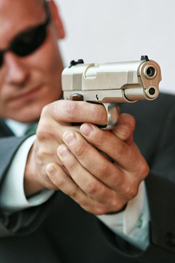 Adult Close-up Day Gun Handgun Holding Human Hand Indoors  Men One Person People Protection Self-defense Weapon