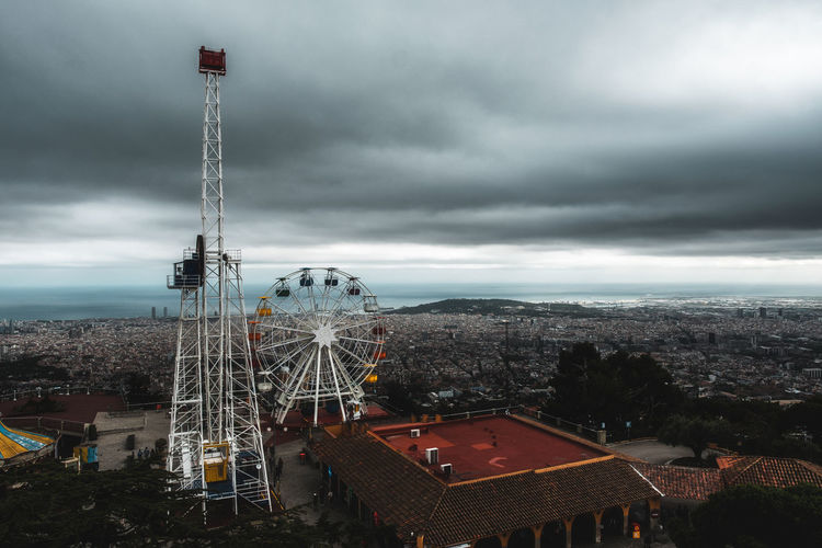 Carnival Funfair Architecture Building Building Exterior Built Structure City Cityscape Cloud - Sky Day High Angle View Leisure Activity Nature No People Outdoors Overcast Residential District Sky Storm Storm Cloud