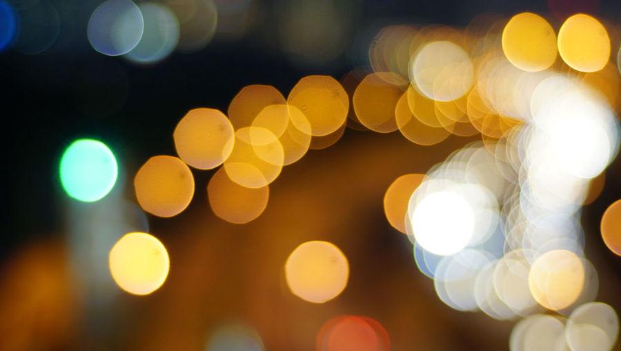 Blurry photo light and bokeh.illuminated at night. Abstract Abstract Backgrounds Backgrounds Circle Defocused Electric Light Geometric Shape Glowing Illuminated Lens Flare Light Light - Natural Phenomenon Lighting Equipment Multi Colored Night Nightlife No People Outdoors Pattern Shape Street Street Light Yellow