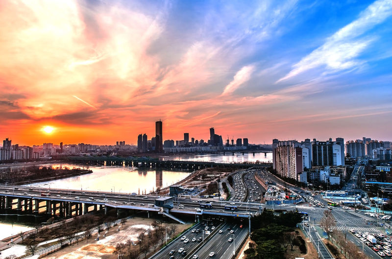 Evening sunset at the Han River in winter South Korea Architecture Bridge - Man Made Structure Building Building Exterior Built Structure City Cityscape Cloud - Sky Modern Multiple Lane Highway Nature No People Office Building Exterior Orange Color Outdoors River Sky Skyscraper Sunset Tall - High Tower Transportation Urban Skyline Water