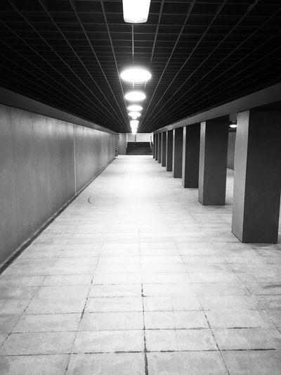 Empty illuminated corridor in building