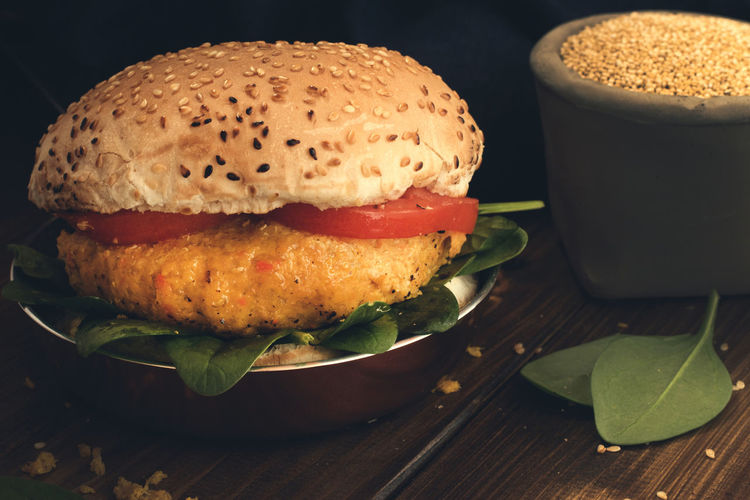 Vegetarian burger with carrot and quinoa on wooden table. Background Burger Diet Food Food And Drink Quinoa Quinoa Burger Still Life Tomato Vegan Vegan Food Vegetarian Vegetarian Food Vegetarianlife Wood Wooden