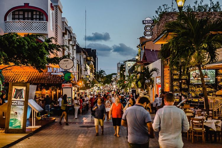 Happy hour in 5ta avenida means TRAFFIC - Playacar - Mexico Playacar Mexico Light Large Group Of People Architecture Built Structure City People Building Exterior Mobility In Mega Cities Travel Destinations Men Women Outdoors Adult Real People Day Sky
