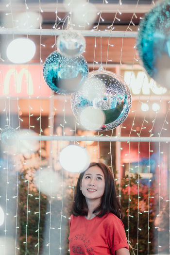Merry Christmas. Christmas Christmas Lights Christmas Decoration Christmas Ornament Christmas Themes Portrait One Person Headshot Happiness Young Women Real People Smiling Women Front View Looking At Camera Young Adult Emotion Transparent Lifestyles Females Leisure Activity Illuminated Casual Clothing Hair Hairstyle