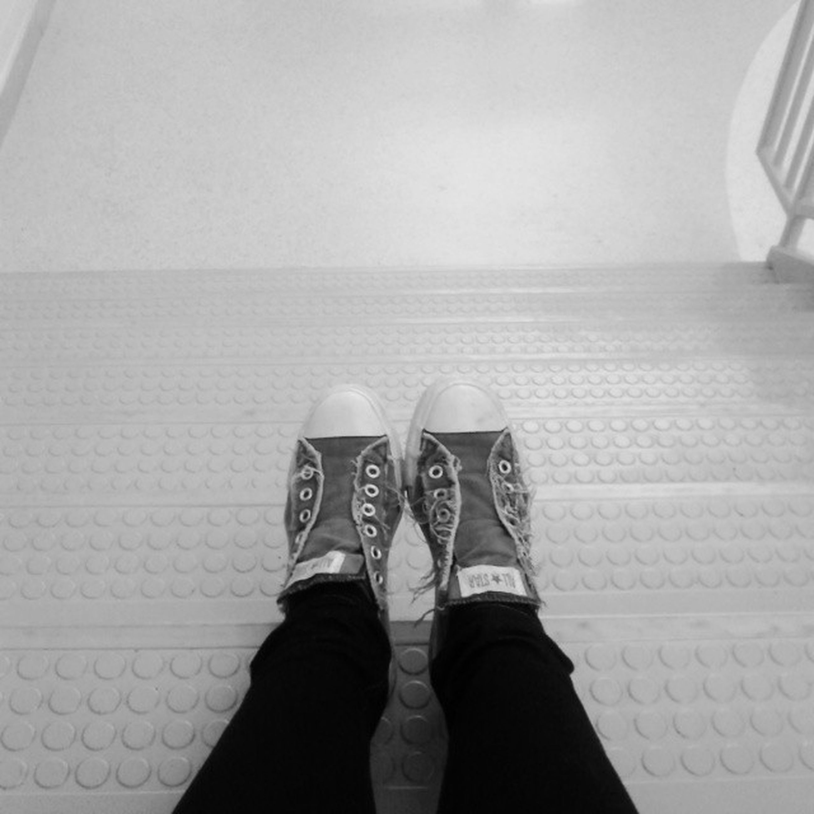 low section, person, shoe, personal perspective, footwear, human foot, standing, lifestyles, jeans, high angle view, indoors, men, part of, unrecognizable person, flooring, directly above, leisure activity
