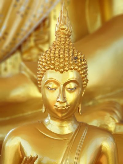 Buddha statue. Background Blur Front Focus Buddha Statue Temple Statue Place Of Worship Religion Buddha Golden Color Buddhism