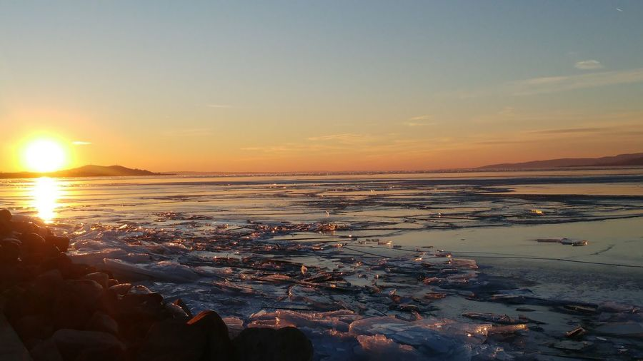 Sunset Water Nature Beauty In Nature Outdoors Sky Landscape Horizon Over Water Cold Temperature Winter Landscape Ice Eyeemphotography EyeEm Nature Lover Wintertime Tranquil Scene No People Hungary Balaton - Hungary