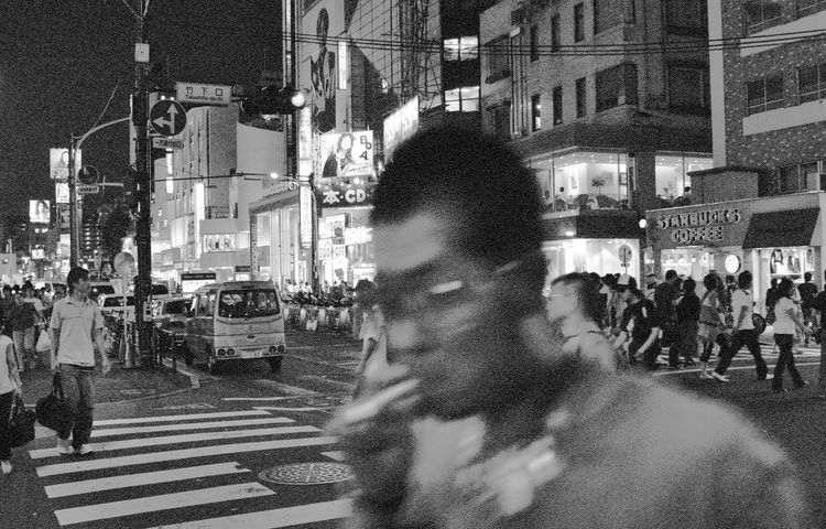 Young guy with cigarette in Harajuku, Tokyo. Harajuku Japan Tokyo Adult Adults Only Architecture Blurred Motion Building Exterior Built Structure Cigarette  City Crowd Large Group Of People Men Motion Night Outdoors People Real People Riot Street Walking
