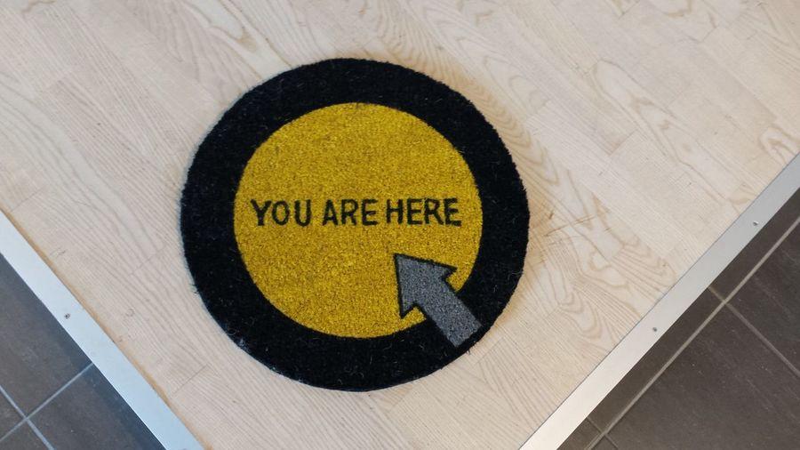 High angle view of doormat on floorboard