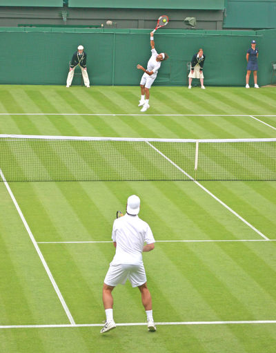 A Singles Tennis Match in the UK Federer Richard Gasquet Adult Athlete Clothing Competition Competitive Sport Day Exercising Full Length Healthy Lifestyle Leisure Activity Men Motion People Playing Racket Roger Federer Sport Sports Clothing Tennis Tennis Racket