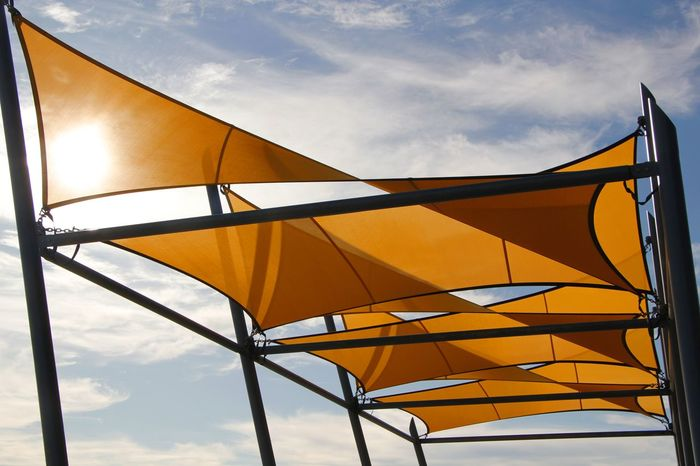 Shade Sails spread to provide protective sun cover Abstract Abstract Photography Arcitecture Cove Cover Protectio Day Decoration Decorative Design Designing Low Angle View No People Outdoors Pattern Prevent Shadeclo Shadecloth Shadow Shelter Style Sun Sunblock Sunset Sunshade Yellow