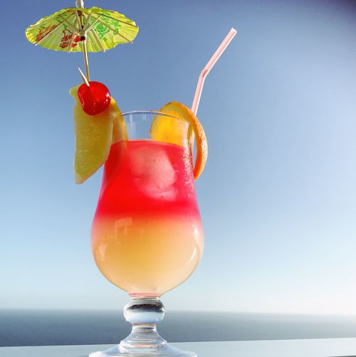Tropical drink Cocktails Drink Cocktail Refreshment Drink Cocktail Alcohol Food And Drink Drinking Glass Freshness Fruit Close-up Summer Drinking Straw Red Wine Horizon Over Water No People SLICE Sky