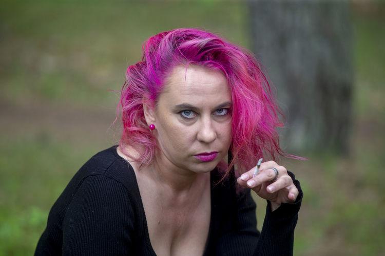 Portrait of woman against purple outdoors