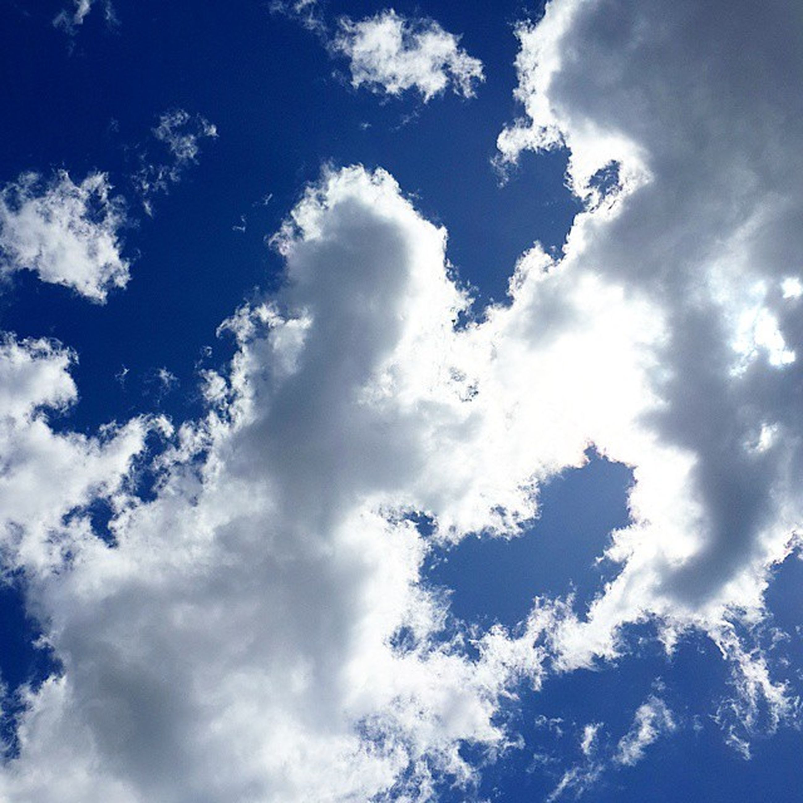 low angle view, sky, sky only, cloud - sky, beauty in nature, tranquility, blue, backgrounds, scenics, nature, full frame, cloudscape, tranquil scene, cloudy, white color, cloud, idyllic, fluffy, day, outdoors