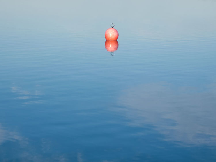 Buoy on the water. Baywatch Red Beauty In Nature Blue Blue Sky Buoy On The Water Day Lake Nature No People Ocean Outdoors People Rescue Sea See Sky Swim Tranquility Water Waterfront