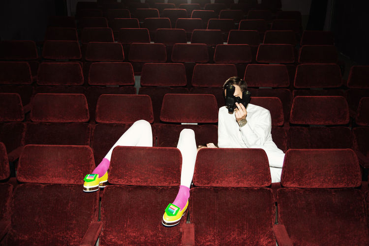 It's a Date Couple Date Linas Was Here Theater Binoculars Cinema Legs Movies Night Pink Socks Red Chairs Shoes Fashion White Clothes Yellow Shoes