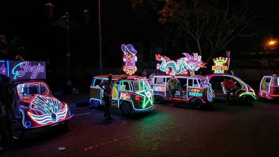 Illuminated toy car on road at night