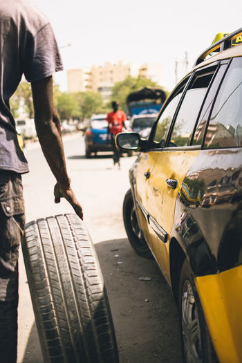Africa EyeEm Best Shots EyeEmNewHere EyeEm Nature Lover Car Motor Vehicle Transportation Mode Of Transportation City Land Vehicle Street One Person Men Day Road Real People Focus On Foreground Architecture Standing City Life Outdoors Nature Rear View