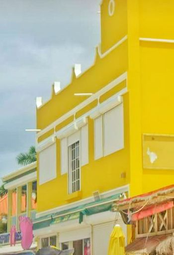 Yellow Building Bright Yellow Architecture Built Structure Building Exterior Outdoors No People Day Street Photography Old Buildings Old Building Exterior Town Beautiful Buildings Bright Colors Colorful City Architecture Buildings Building Structures Small Business Small Town Lines And Angles Angles