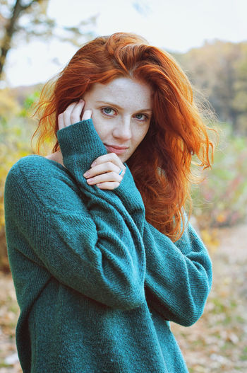 Portrait of a young redhead woman with freckles.