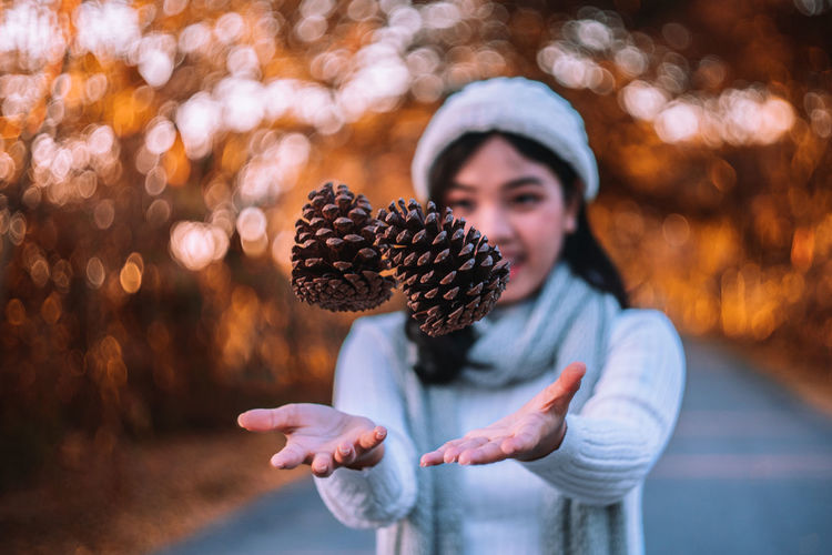 """Autumn is here."" Pine cones in hand. Autumn Autumn Leaves Autumn🍁🍁🍁 Autumn colors Autumn Collection Pine Tree Pine Pine Woodland Pine Cone Pine Cones Nature Food Portrait Adult Lifestyles Day Hand Waist Up Holding Focus On Foreground Winter Christmas Celebration Vintage Colorful"