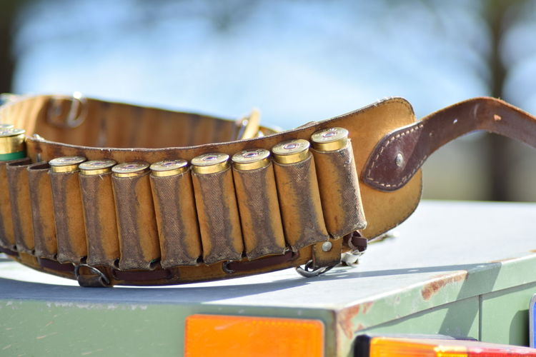 Close Up Of Bullets In Cartridge Belt On Box