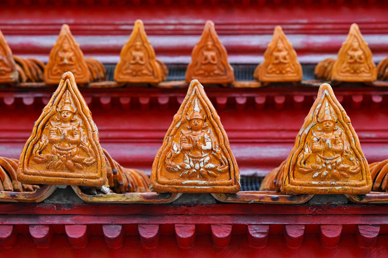 Close-up of sculpture on roof of temple