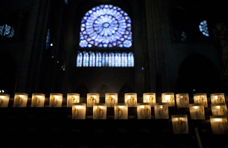 Inside Notre Dame before the fire. Notre Dame De Paris Notre-Dame Notre Dame Cathedral Religion Spirituality Illuminated Place Of Worship Architecture Window Stained Glass Candle Built Structure No People