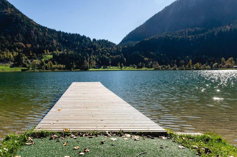 Steg am Thiersee Tirol  Bergsee See Thiersee Water Plant Tree Lake Beauty In Nature Tranquility Scenics - Nature No People Outdoors Nature Day Sunlight Reflection Lakeshore Idyllic Sky
