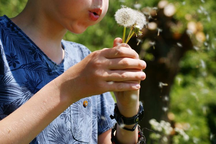 Hanging Out Taking Photos Enjoying Life Enjoying Nature Dandelion Blowing Seeds Dandelion Seeds Boy Make Magic Happen Make A Wish Holding On Holding Nature On Your Doorstep Nature Naturelovers