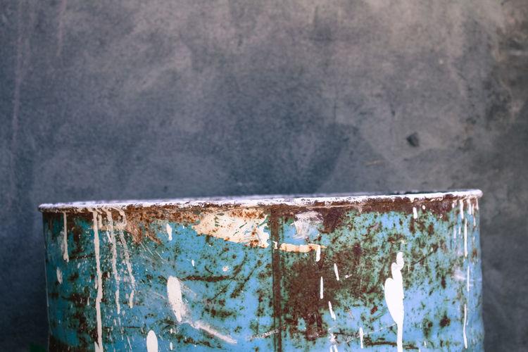 Close-up of rusty barrel.