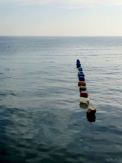 Sea Outdoors Scenics Water Horizon Over Water Beauty In Nature Day Tranquility Nature Sky Sea And Sky Buoy Buoy On The Water