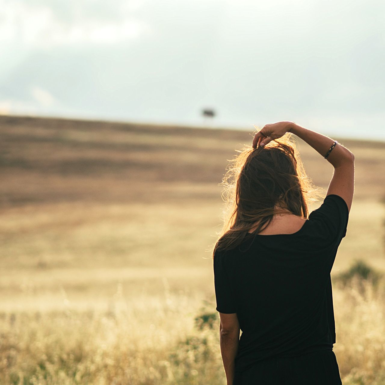 Woman Overlooking Countryside Landscape