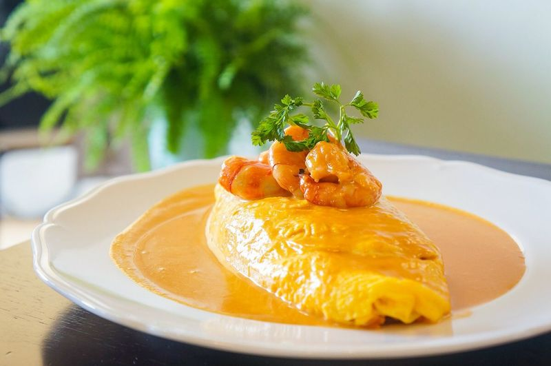 Omelet With Prawns On Top Served In Plate