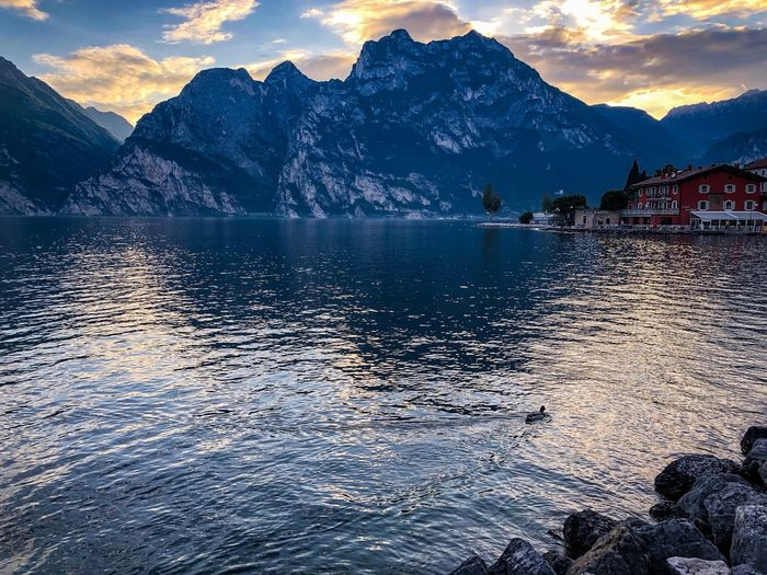 Gardalake Mountain Water Sky Beauty In Nature Mountain Range Scenics - Nature Nature Cloud - Sky Lake Tranquil Scene Sunset Waterfront Tranquility No People