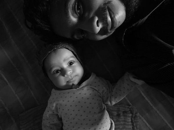 EyeEm Selects Baby Portrait Looking At Camera Two People Togetherness Happiness Childhood People Bonding Smiling Indoors  Cute Love Adult Females Child Close-up Black Background Babies Only Day
