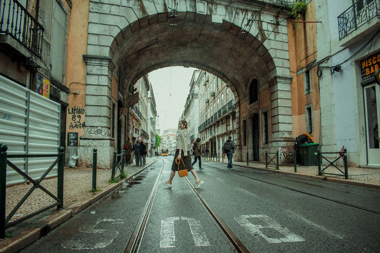 Architecture Transportation Built Structure Arch Building Exterior City Day Rail Transportation Direction Mode Of Transportation Railroad Track Sign The Way Forward Track Group Of People Street Road Incidental People Real People Symbol Outdoors Lisbon - Portugal