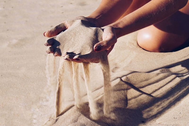 Sand Sand Dune Dunes Pouring Sandy Beach Tranquility Desert Outdoors Environment Therapy Hands Real People One Person Sunlight Human Body Part Women Nature Lifestyles Shadow Sand Leisure Activity Outdoors Midsection