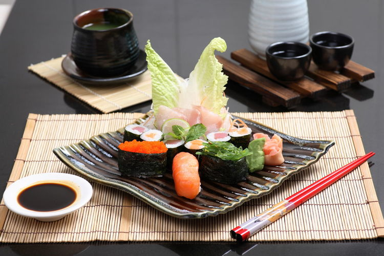 Sushi in plate on table