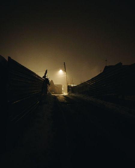 Windmill in winter at night