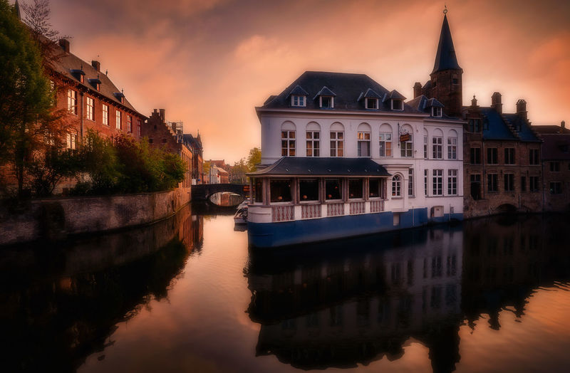 Brugge Remo SCarfo Sunrise Belgium Reflection Lake cityscapes EyeEmNewHere EyeEm Selects EyeEm Gallery Europe Travel Chocolate BrugesCanal Morning Mood Building Exterior Water Built Structure Architecture Reflection Sky Building Waterfront Nautical Vessel Nature River Cloud - Sky City Travel Destinations Dusk Transportation No People The Past Outdoors Passenger Craft