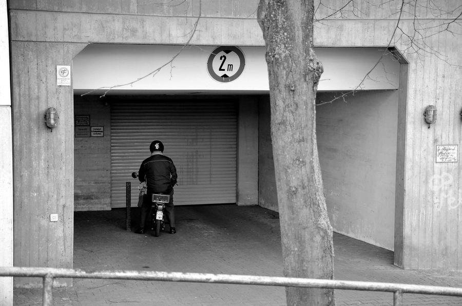 Tiefgarage Garage People Moped Bnw One Person Blackandwhite Garagedoor Skuril Waiting Berlindubistsowunderbar Warten Underground Car Park Underground Einfahrt Freihalten Entrace Berlin Photography