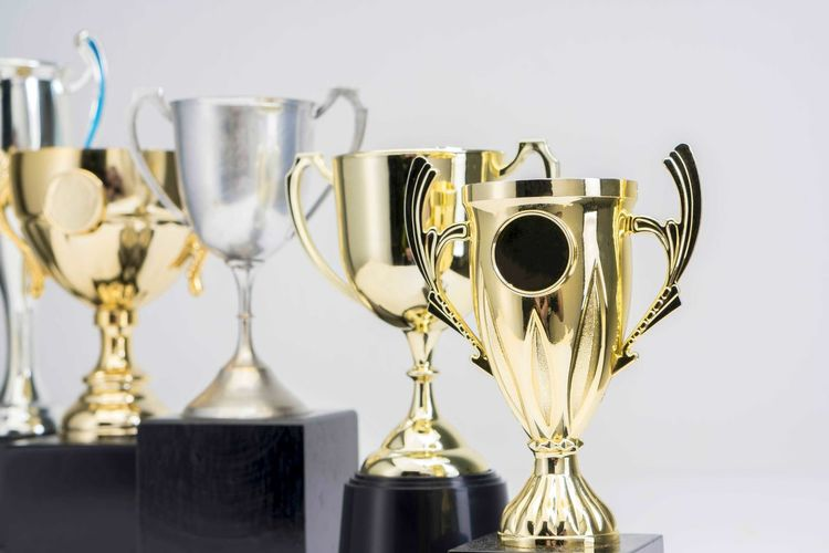 Variety of Trophy Cup on white background AWARD Trophy Achievement Still Life Indoors  Success Winning No People Metal Gold Colored Studio Shot Close-up Competition Table Shiny Silver Colored Instrument Of Measurement Reflection Wood - Material