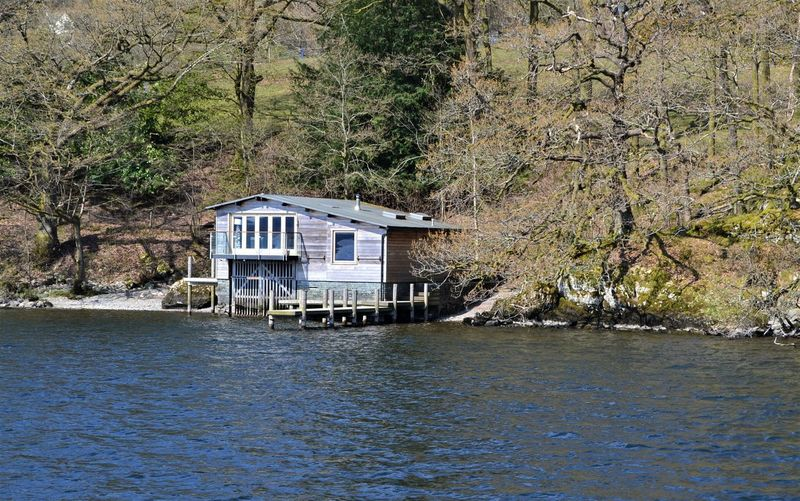 Wooden boat house with a jetty and decking on the shore of Lake Windermere, Cumbria, UK Water Tree Architecture Built Structure Waterfront Building Exterior Plant Day House No People Building Nature Beauty In Nature Land Forest Outdoors River Residential District Boathouse Boat House Windermere Cumbria Boat Trip