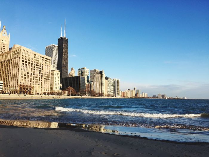 View from Ohio Street Beach Chicago Cold But Beautiful Cold Day City Beach Winter Architecture Built Structure Building Exterior Travel Destinations Water Skyscraper Sea Tourism Clear Sky Travel Urban Skyline Wave City Outdoors Sky Beach No People Blue The Traveler - 2018 EyeEm Awards