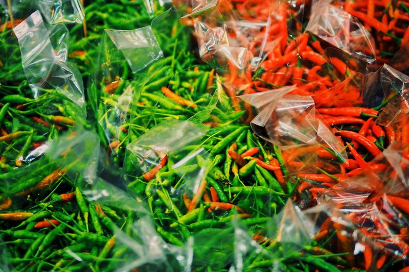 Green Color No People Close-up Full Frame Plastic Nature Backgrounds Day Selective Focus Abundance Transparent Bag Plant Freshness Food And Drink Retail  Grass Outdoors Plastic Bag
