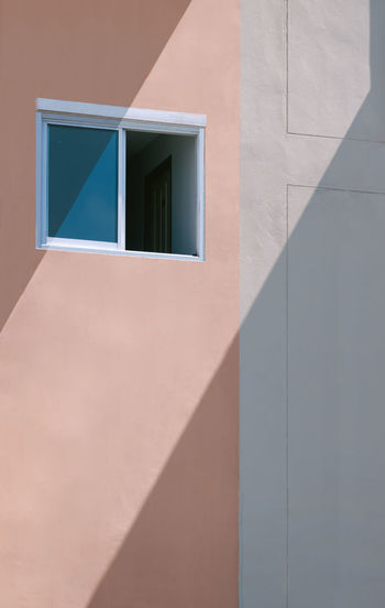 Shadow of window on wall of building